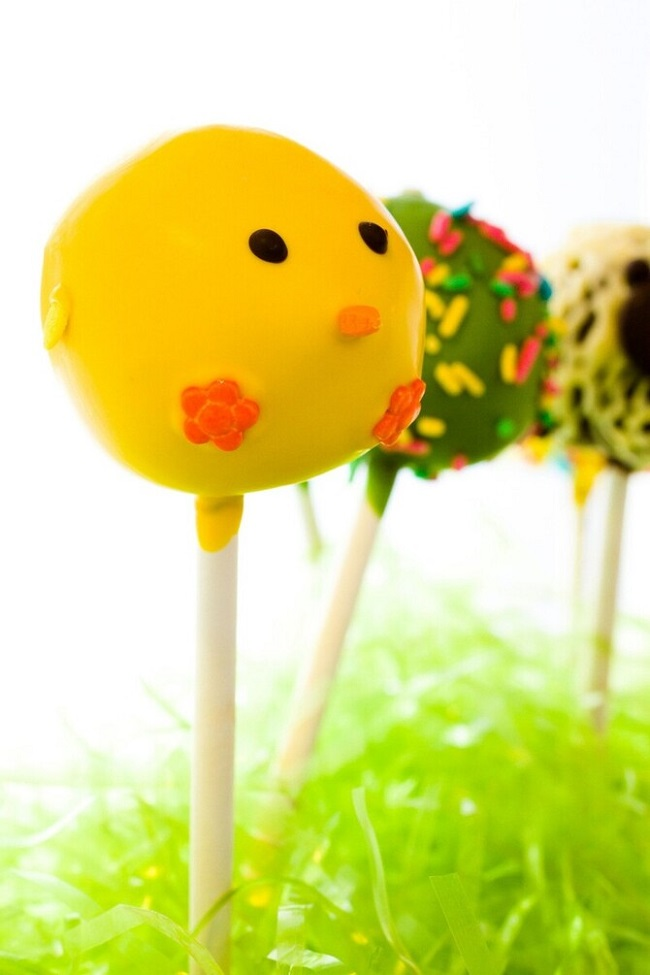 Dark chocolate Easter cake pops decorates with faces of different animals.